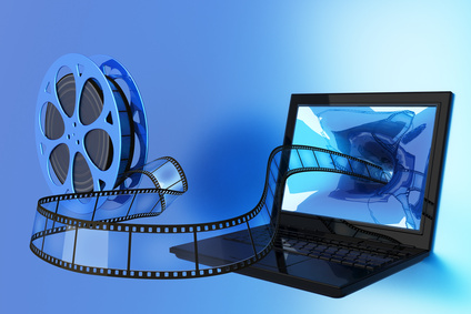 An unraveling film reel entering a laptop computer screen